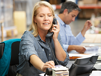 Employee Assistance Program representative on phone making referrals for employees