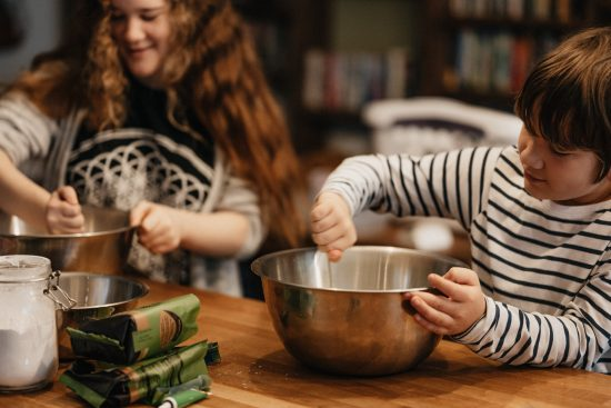 boy and girl baking in kitchen