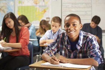 Kids in classroom at school.