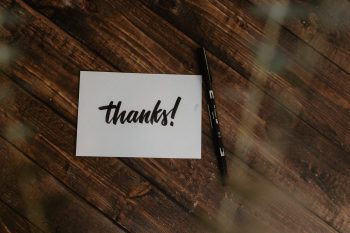 """Table with and """"Thanks"""" card on it"""