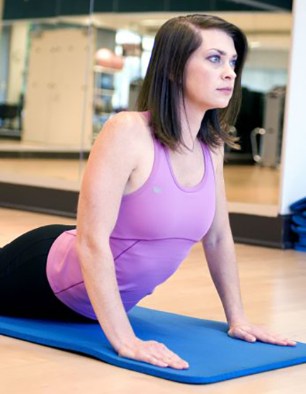 Woman practicing Yoga to positively impact mood